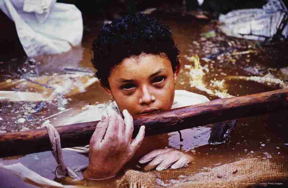 Omayra Sánchez was one of the 25,000 victims of the Nevado del Ruiz (Colombia) volcano which erupted on November 14, 1985. The 13-year old had been trapped in water and concrete for 3 days. The picture was taken shortly before she died and it caused controversy due to the photographer's work and the Colombian government's inaction in the midst of the tragedy, when it was published worldwide after the young girl's death. Photographer Frank Fournier