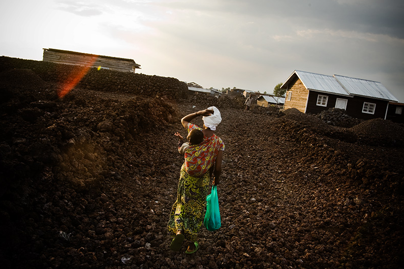 eanine Kahindo, 28, walks through lava rocks in the Majengo neighborhood in Goma, Eastern Democratic Republic of Congo on Saturday December 20, 2008. Photo by photojournalist Olivier Asselin