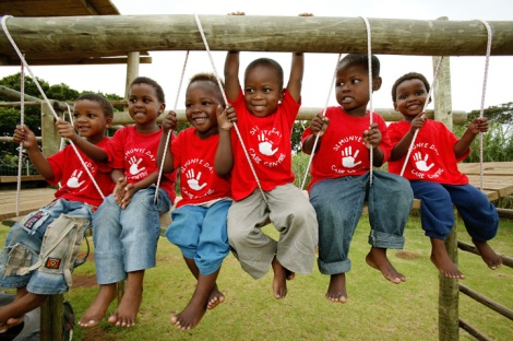 South Africa: Children play on a swing at a community creche for disadvantaged children whose parents are HIV-positive 1 March 2004 in East London, South Africa.  © Brent Stirton/Getty Images