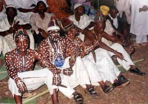 Praying Obatala priests in their temple in Ile-Ife in southwestern Nigeria