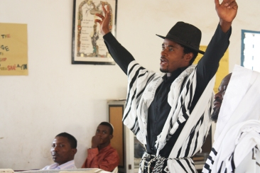 A prayer leader at the Ghihon Synagogue raises his arms in prayer Photo by Chika Oduah