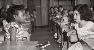 The Supreme Court's decision in Brown v. Board of Education integrated the schools. But today its meaning is at issue. Here, the first day of desegregation, on Sept. 8, 1954, at Fort Myer Elementary School in Fort Myer, Va.