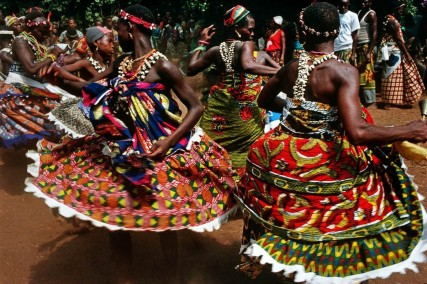 Dancers in Benin prepare for a ritual ceremony
