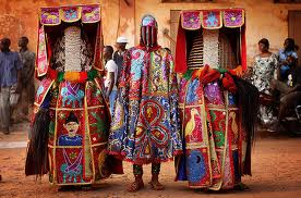 Nigerian Yaruba dressed as voodoo spirits perform during a voodoo ceremony in Ouidah, Benin. Each spirit represents the reincarnation of a dead member of the Nigerian Nagu clan. Photograph: Dan Kitwood/Getty Images