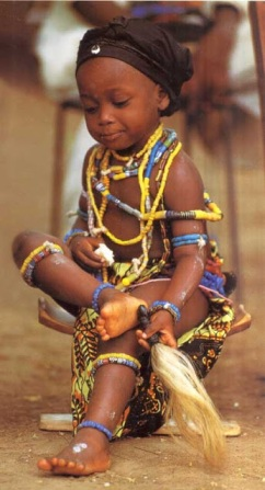 A young Krobo girl adorned in traditional beads