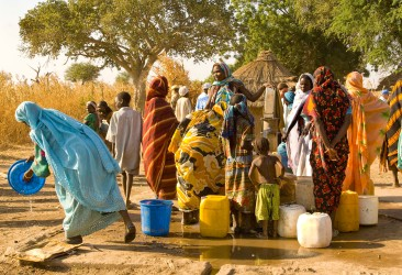 Women pump water for cooking and cleaning at a water point in the IDP site at Gassire, near Goz Beida, Chad.© UN/Olivia Grey Pritchard