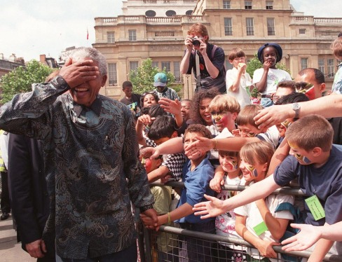 South Africa's President Nelson Mandela walks amongst the vast Trafalgar Square crowd in London Friday July 12 1996. The President later addressed the crowd from the balcony of South Africa House on this, the last leg of his four-day State visit to Britain. (AP PHOTO / DAVE CAULKIN/ WPA POOL)