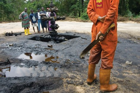 Scenes in Oloibiri Town, Niger Delta. An oil spill from an abandoned Shell Petroleum Development Company well in Oloibiri, Niger Delta.  Wellhead 14 was closed in 1977 but has been leaking for years, and in June of 2004 it finally released an oil spill of over 20,000 barrels of crude. Workers subcontracted by Shell Oil Company clean it up.
