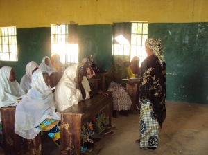Girls and women in northern Nigerian attending a literacy class organized by the Isa Wali Empowerment Initiative