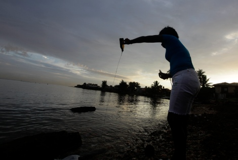 Mayra, a Cuban spiritualist and fortune teller, performs a Santeria ritual on a beach in Havana, October 17, 2012. Mayra is a practiser of Santeria, a fusion of religions of West African origin with Roman Catholic Christianity that was not allowed after the 1959 Revolution but was eventually tolerated and today even thrives. The center of Santeria is Cuba, but it has spread to the United States and other nearby countries. REUTERS/Desmond Boylan (CUBA)