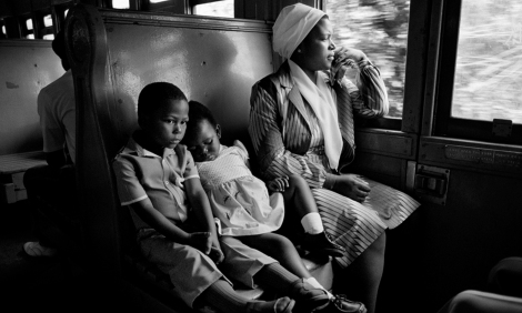 ca. 1986, South Africa --- South African Family Traveling on a Train --- Image by © David Turnley/CORBIS