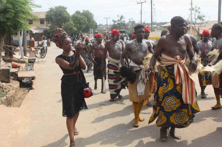 Filming warriors and elders in a ceremonial procession in Ugep, Cross River Nigeria