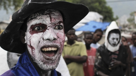 A vodou worshipper takes part in festivities on the first day of the Haitian Festival of Ancestors in Port-au-Prince.
