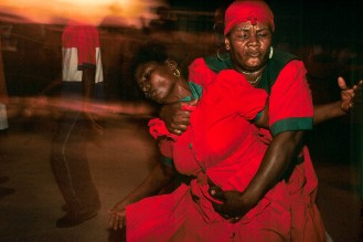 HAITI, CROIX-DES-BOUQUETS. Ceremony dedicated to St. John the Baptist. Two mambos (voodoo priestesses) are in a trance, possessed by the loas (spirits) in October 1995. Photo by Jean-Claude Coutausse