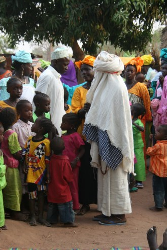 A fulani wedding in Senegal with the bride covered in white