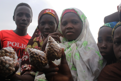 "Children along the road selling nuts and saying ""Allah ya kikaye"". Photo by Chika Oduah"