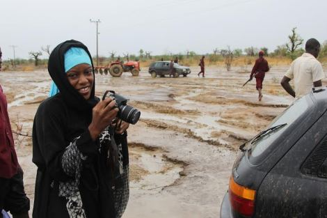 Me, Chika Oduah, on a rainy day on Chibok Road.