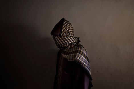 A member of Boko Haram, an Islamist group behind several deadly attacks in northern Nigeria, in a suburb of Kano, Nigeria, Feb. 12, 2012. The deadly militant Islamist group, thought to be aided by outside terrorist groups, has local roots to the anger it expresses at the Nigerian State.  (Samuel James/The New York Times)