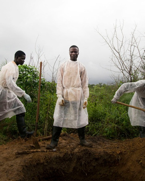 Burial team buries an Ebola victim. Unification Town, Liberia. Photo by Kieran Kesner
