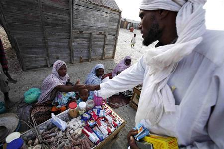 A Mauritanian man buys goods in the Keube slum in the capital Nouakchott in this March 13, 2007 picture. Herding camels or goats out in the sun-blasted dunes of the Sahara, or serving hot mint tea to guests in the richly carpeted villas of Nouakchott, Mauritanian slaves serve their masters and are passed on as family chattels from generation to generation. CREDIT: REUTERS/FINBARR O'REILLY