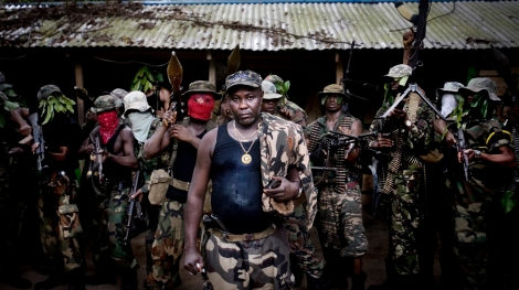 Ateke Tom, the big chief of the Mend, with his boys, in one of the eleven camps he ruled in the mangrove of the Niger delta. Feb 9 2009. (Photo by Veronique de Viguerie/ Getty Images)