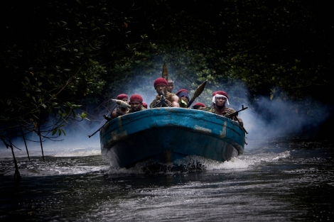 NIGER DELTA, NIGERIA-JULY 2009-Atteke Tom boys are arriving to their camp 9 hidden in the mangrove (Photo by Veronique de Viguerie/ Getty Images)