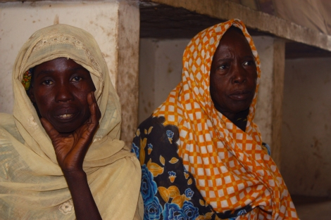 Isa Bukar, 50, fled Bama after Boko Haram insurgents killed her husband in the southern Borno town of Bama. Isa Jibrin, 60, does not know whether her husband is alive. Both women stay in a camp for displaced people in the Borno State capital of Maiduguri in northeastern Nigeria. Photo by Chika Oduah. Maiduguri, Nigeria.  December 16, 2014.