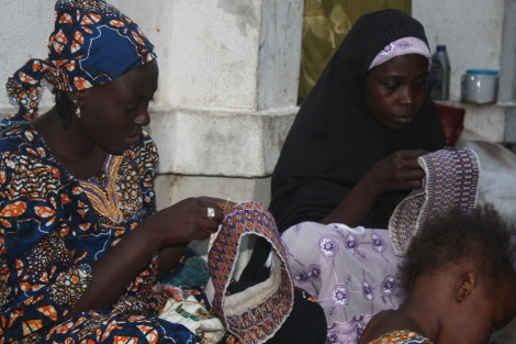 Nigerian women whose husbands were killed by members of the Islamist sect Boko Haram, band together, sewing hats to earn some cash in Maiduguri in northeastern Nigeria. Photo by Chika Oduah. December 16, 2014.