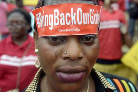 "A woman with a sticker on her head bearing the slogan ""Bring back our girls"" marches for the release of the more than 200 abducted Chibok school girls in Lagos on May 29, 2014, during a demonstration by civil society groups and celebrities of the film and entertainment industries to press for the girls' release, seven weeks after their abduction by Islamist militant group Boko Haram, and on the occasion of Nigeria's Democracy Day.  Nigerian President Goodluck Jonathan vowed on May 29 total war against terrorism as the country's security forces stepped up efforts to rescue more than 200 schoolgirls kidnapped by Boko Haram Islamists 45 days ago. AFP PHOTO/PIUS UTOMI EKPEIPIUS UTOMI EKPEI/AFP/Getty Images"