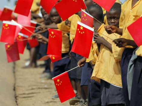 Liberian children hold Chinese flags before the arrival of China's President Hu Jintao in Monrovia February 1, 2007.