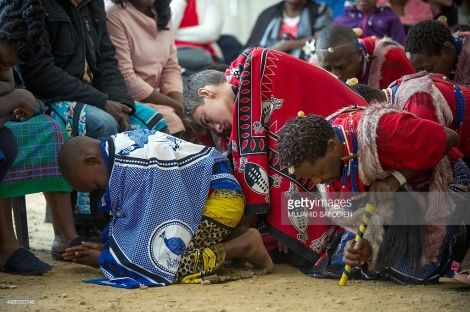 Twelve-year-old South African Kyle Todd (C) performs during his initiation ceremony to become a Sangoma or traditional healer at a traditional healer school on November 14, 2015, in Pretoria, South Africa. South African traditional healers are practitioners of traditional African medicine in Southern Africa. They fulfill different social and political roles in the community, including divination, healing physical, emotional and spiritual illnesses, directing birth or death rituals, finding lost cattle, protecting warriors, counteracting witches, and narrating the history, cosmology, and myths of their tradition. AFP PHOTO / MUJAHID SAFODIEN