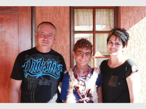 Kyle Todd (11), a mlungu sangoma (white traditional healer), together with his parents Michael and Chantal.