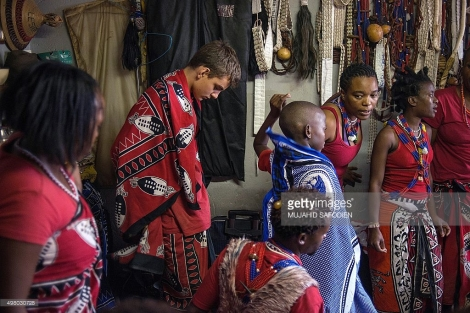 Twelve-year-old South African Kyle Todd (2nd L) gets ready for his initiation ceremony to become a Sangoma or traditional healer at a traditional healer school on November 14, 2015, in Pretoria, South Africa. South African traditional healers are practitioners of traditional African medicine in Southern Africa. They fulfill different social and political roles in the community, including divination, healing physical, emotional and spiritual illnesses, directing birth or death rituals, finding lost cattle, protecting warriors, counteracting witches, and narrating the history, cosmology, and myths of their tradition. AFP PHOTO / MUJAHID SAFODIEN