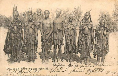 A historic postcard features Herero men and women