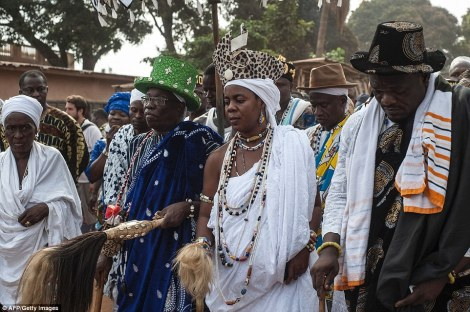 King Daagbo Hounon (centre left), Chief of the Voodoo religion in Ouidah, walks through the streets during the annual Voodoo Day celebration on January 10, which had a very political tone this year. AFP/Getty Images