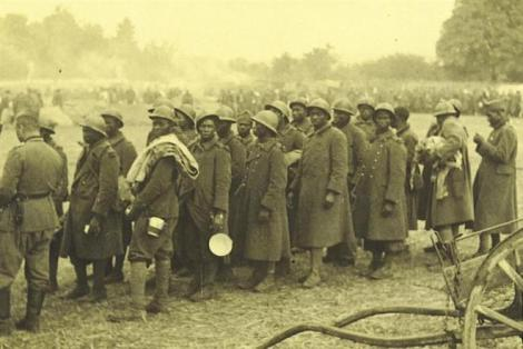French prisoners-of-war being rounded up by German soldiers after the fall of France, June 1940