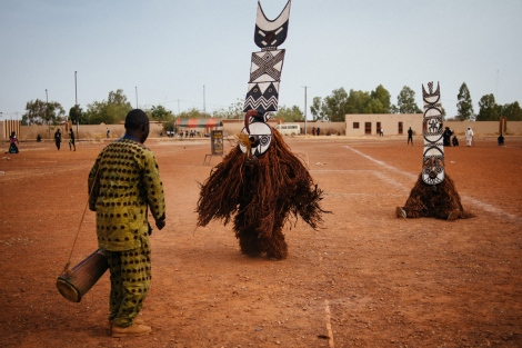 Fiber masks from Boni village (Burkina Faso) perform in the Regional Stadium of Dedougou. Music is essential, played with traditional African nstruments, accompanies very ritual and ceremony. Photo by Jacob Balzani Loov