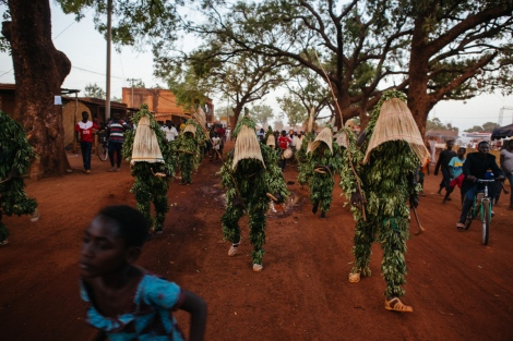 Leaves masks from Dedougou parade in their own town. Photo by Jacob Balzani Loov