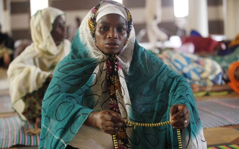 Nigerian Muslim women offer prayers on the first Friday of Ramadan at the central Mosque in Lagos, Nigeria