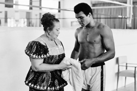 "In this photo taken on October 27, 1974 US boxing heavyweight champion Muhammad Ali (born Cassius Clay) stands with her mother Odetta Lee Clay during a training session three days before the heavy weight world championship in Kinshasa. On October 30, 1974 Muhammad Ali knocked out George Foreman in a clash of titans known as the ""Rumble in the Jungle"", watched by 60 000 people in the stadium in Kinshasa and millions elsewhere. AFP/Getty Images"