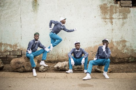 Members of the Rea Iketsetsa posing in their signature fashion in Soweto. Photo by: Chris Saunders