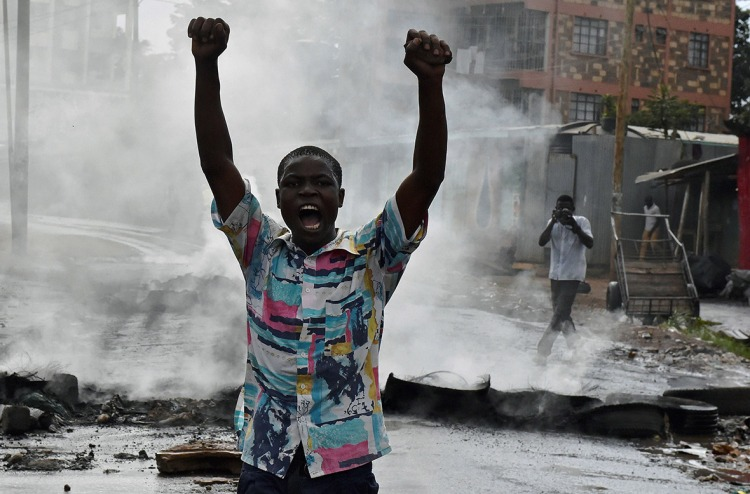 Protesters, like this man in Nairobi's Kibera slum, have been calling for a change of leadership at the electoral commission in riots which left three dead on 23 May Carl de Souza/AFP
