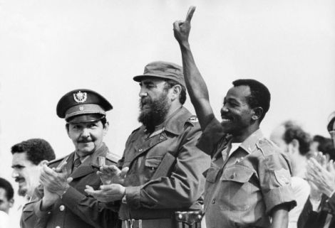 Then Ethiopian President Lieutenant Colonel Mengistu Haile Mariam (R) makes V sign alongside Fidel Castro